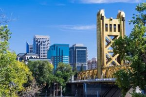 View towards the Tower Bridge and the skyscrapers in downtown Sacramento on a sunny day