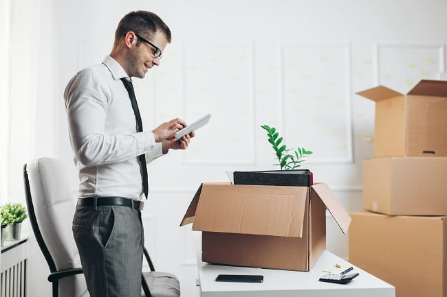 Businessman moving into a new office, office movers